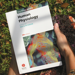 Photo of a student holding the textbook